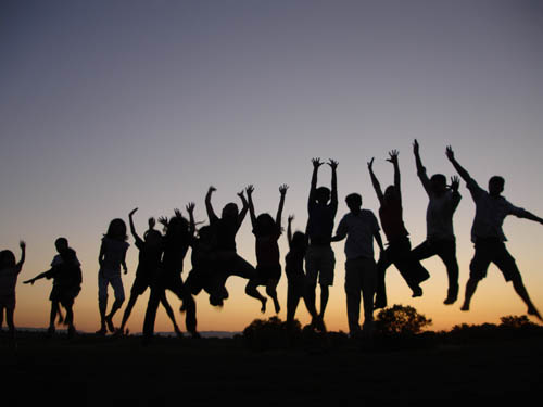 childrenjumping_sunset
